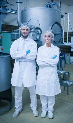 Food,Technicians,Smiling,At,Camera,In,A,Food,Processing,Plant